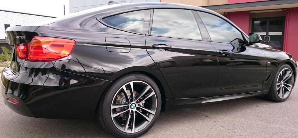 Window tinting on a new BMW at Diamond Paint Protection offers new car window tinting in Perth WA.